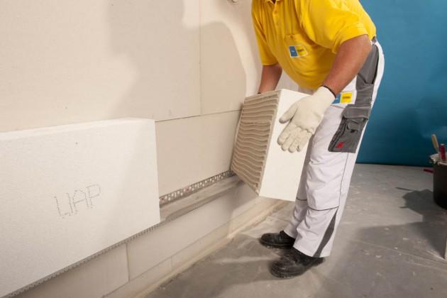 Sandsteinplatten auf einem Trägergewebe werden dieses Wärmedämm-Verbundsystem verschönern und schützen.