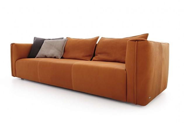 In robustes, sinnlich greifbares Leder kleidet sich hier das klassische, bodennahe Sofa Neo und hat so das Zeug zum langlebigen Liebhaberstück.