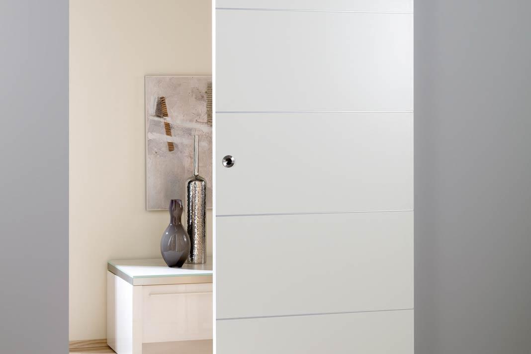 """""""Infinity"""" bedient drei verschiedene Einbausysteme vor und in der Wand, für Holz- und Ganzglastüren."""
