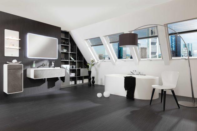 Edles Dunkelgrau und cleanes Weiß schaffen ein klares, seriöses Design. Die über die gesamte Dachseite angelegte Fensterfront erlaubt einen herrlichen Ausblick. Foto: Velux Deutschland GmbH