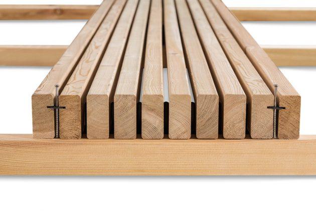Die Konstruktion kombiniert unsichtbare Befestigungssysteme und aufrecht stehende Holzlamellen zu einem langlebigen Komplettsystem. Foto: Mocopinus