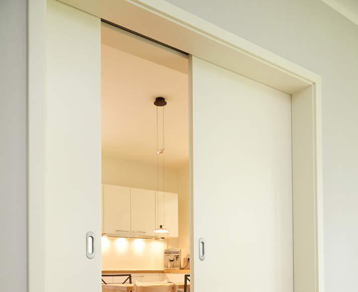 Küche und Ess-Wohnbereich sind durch Schiebetüren abtrennbar.