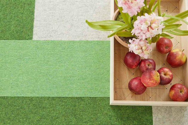 Grüne und weiße Teppichfliesen