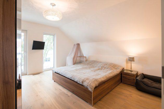 Gemütliches Elternschlafzimmer im individuellen Familienhaus - FingerHaus GmbH